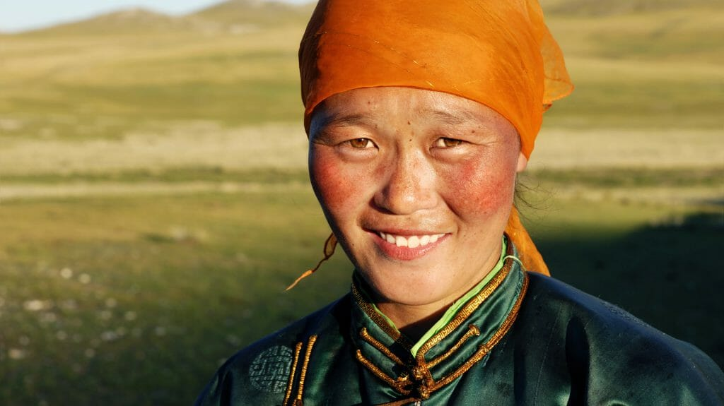 Beautiful young Mongolian lady in the late afternoon sun, Mongolia