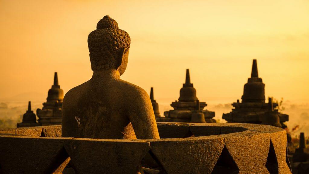 Buddha Statue in Stupa, Borobudur, Yogyakarta, Java, Indonesia