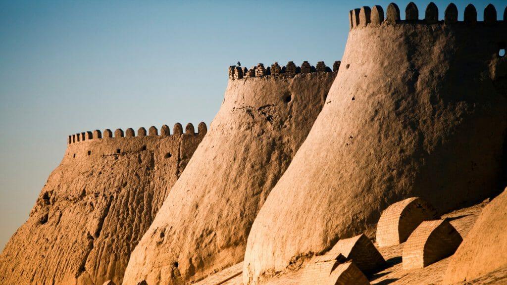 Curved mud brick walls and ramparts of  Khiva ancient city walls.