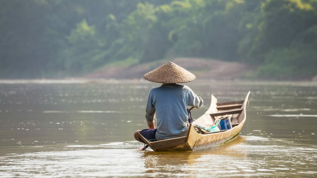 Man on river boat, Luang Prabang, Laos