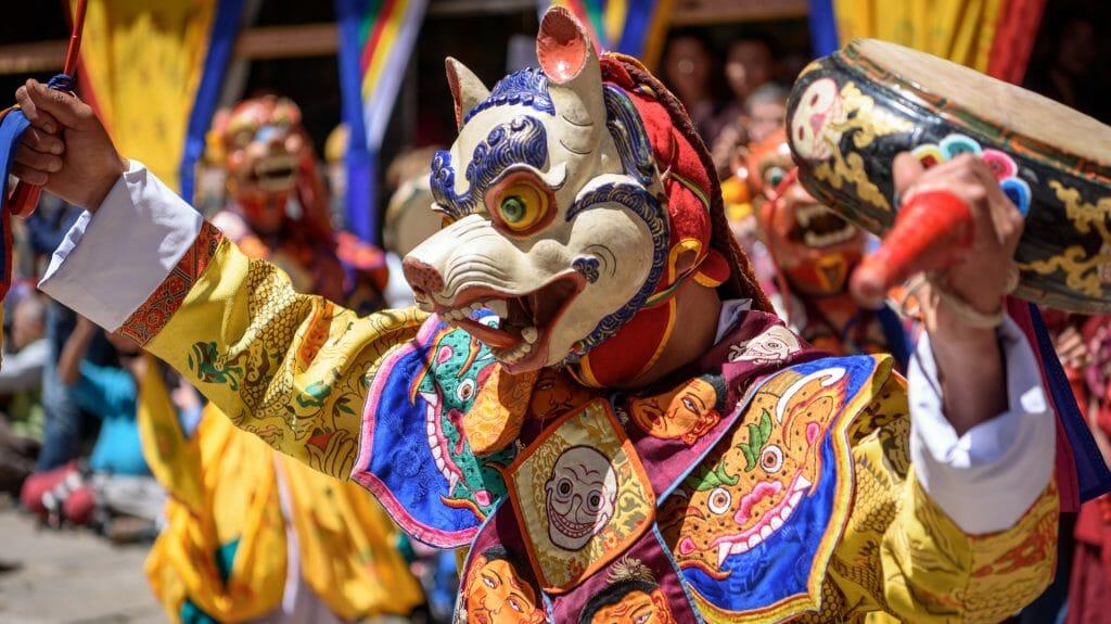 Monk enjoying his colorful mask dance at yearly Paro Tsechu festival in Bhutan, Paro, Bhutan