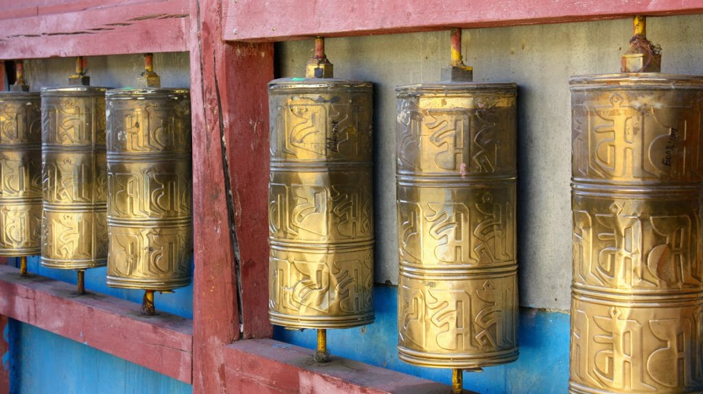 Row of buddhist prayer wheels in Gandan Monastery, Ulaanbaatar, Mongolia