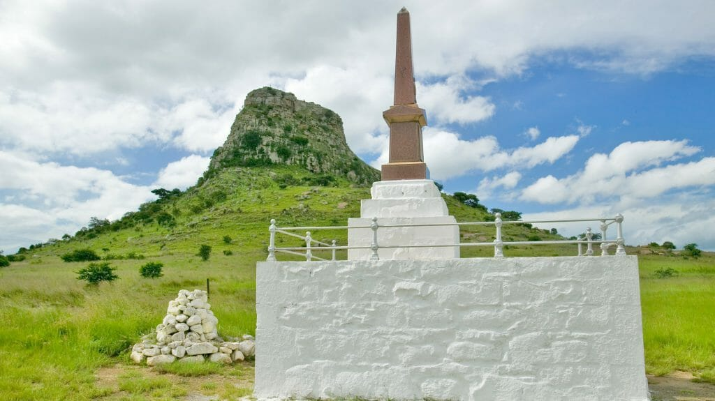 Sandlwana hill or Sphinx with soldiers graves in foreground, KwaZulu Natal Battlefields, South Africa