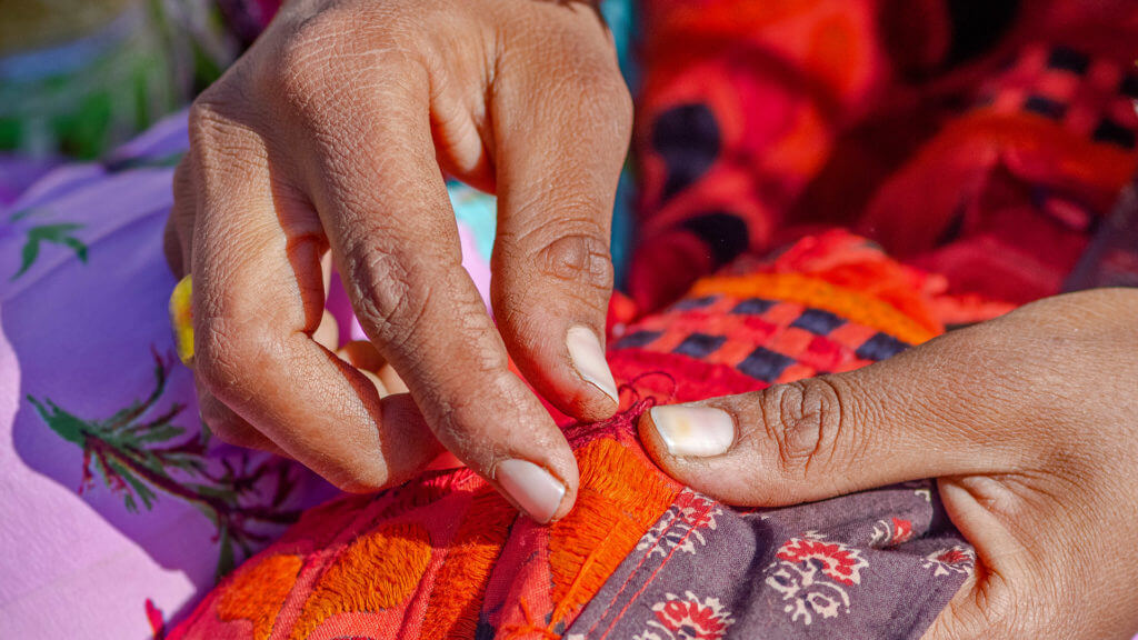 Hands of artist making Embroidery work at Banni area, Bhuj, Gujarat, India
