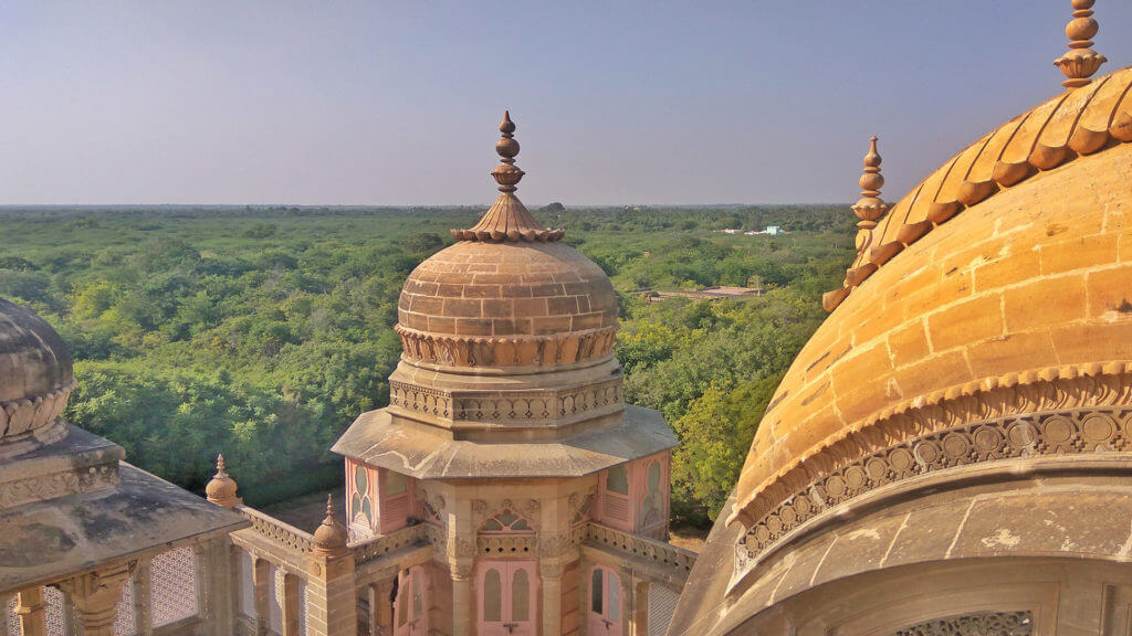 Mandvi, Gujarat, India - The historic Vijaya Vilas Palace sits amidst tropical vegetation near Mandvi, Gujarat, India
