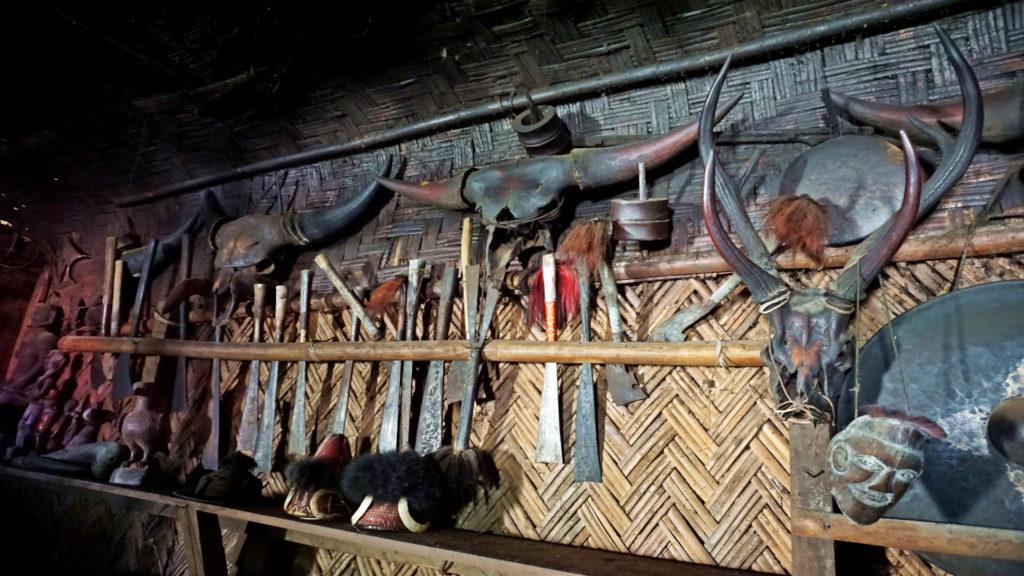 various animal skulls and armory, decoration for longhouse, Longwa, Nagaland, India