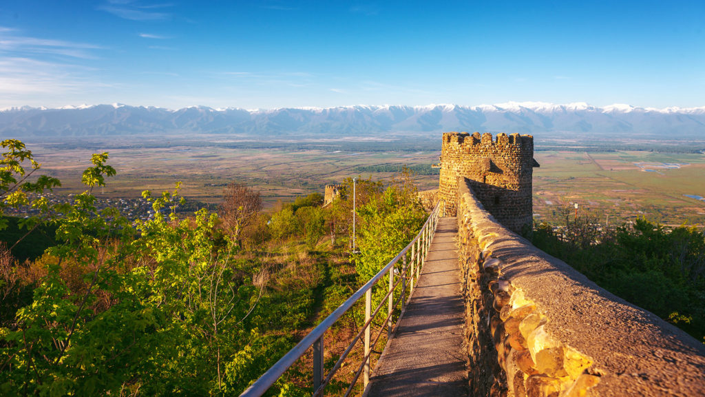 View on Alazan Valley and part of the city wall with fortified tower fortress historical town Signagi, Kakheti region, Georgia