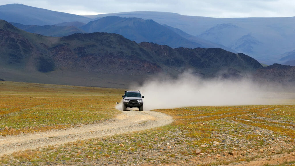 4x4 on road in the desert mountain of the Mongolia