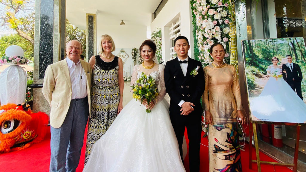 Clients with bride and groom at vietnamese wedding