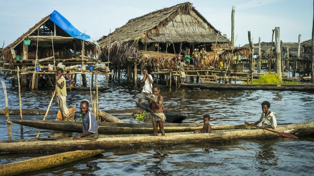 Children on boats, True North Boat, Admiralty Islands, Papua New Guinea