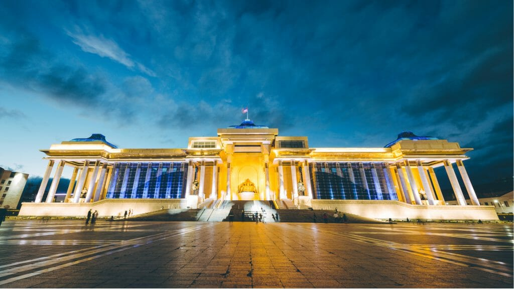 Evening view from Chinggis Square towards government palace which is lit in the early evening light