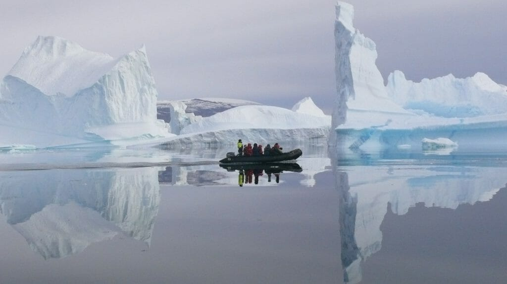 Iceberg reflections with zodiac, Greenland
