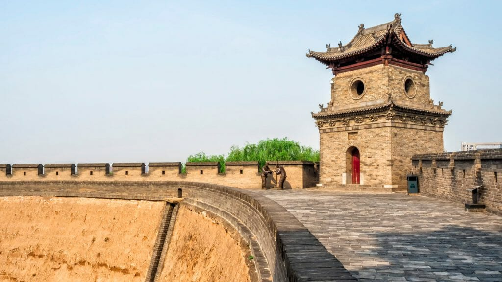 Curved section of Pingyao city walls with tower.