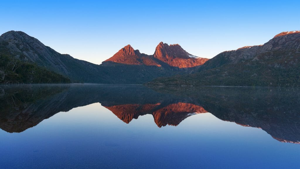 Cradle Mountain landscape reflected in lake Dove, Cradle Mountain National Park, Tasmania, Australia