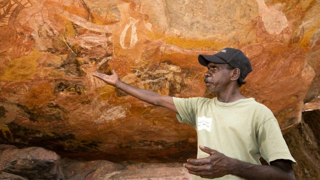 Aboriginal guide explaing rock art.