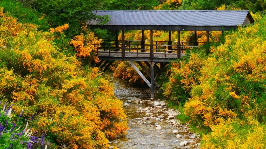 Wood covered bridge in the small town of Villa La Angostura