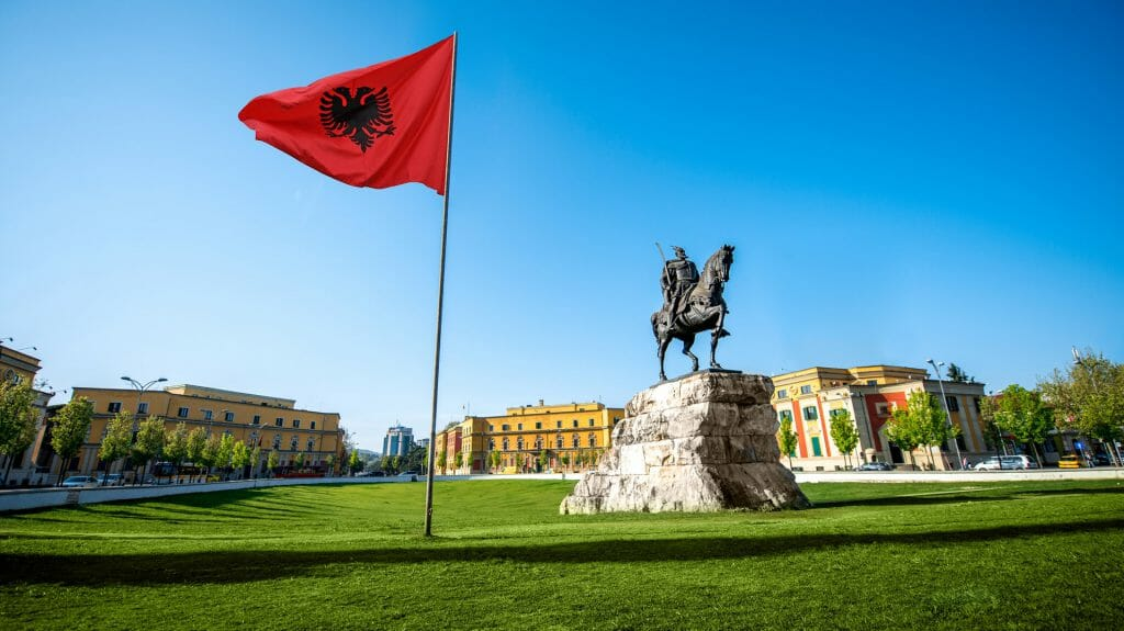 Skanderbeg square with flag and monument in the center of Tirana city in Albania