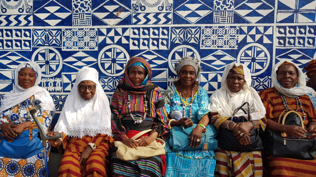 Women in front of wall, Foumban, Cameroon