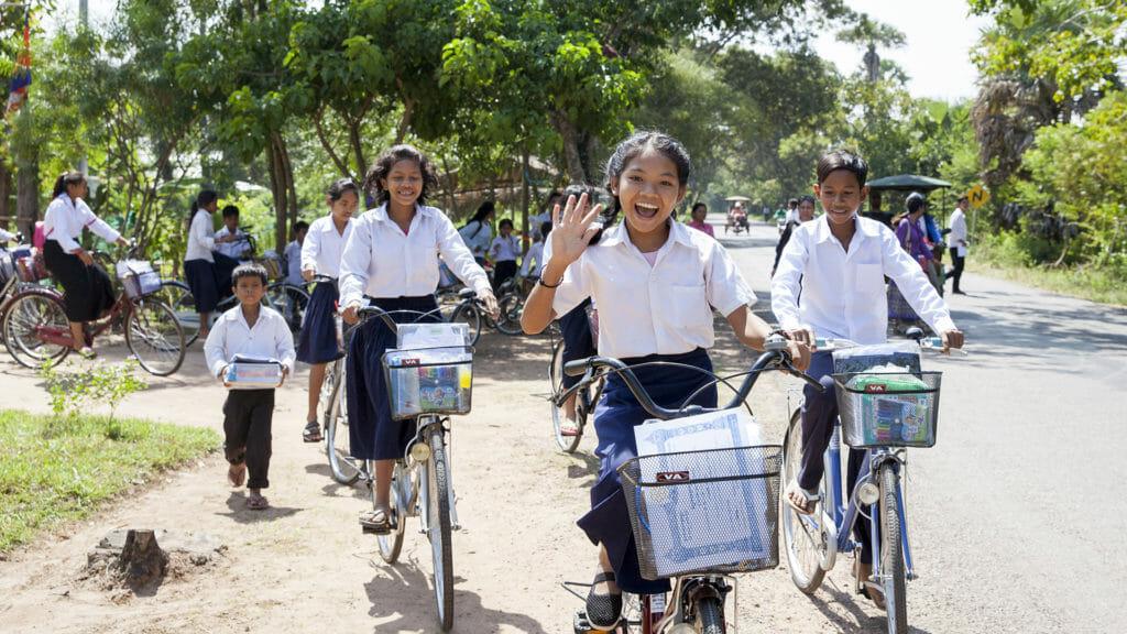 Ponheary foundation girls on bikes waving