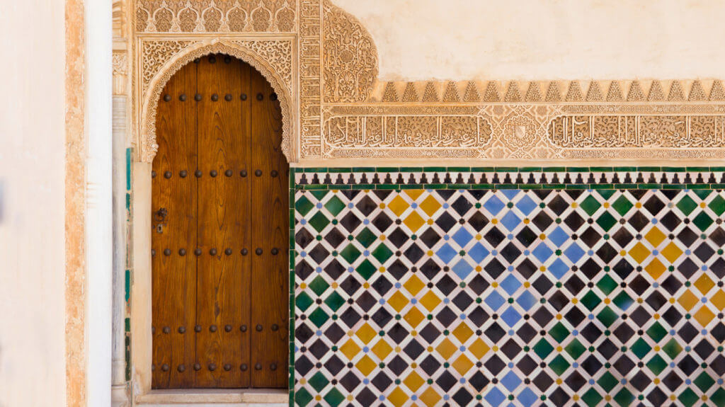 ornate arabic door in alhambra, Spain